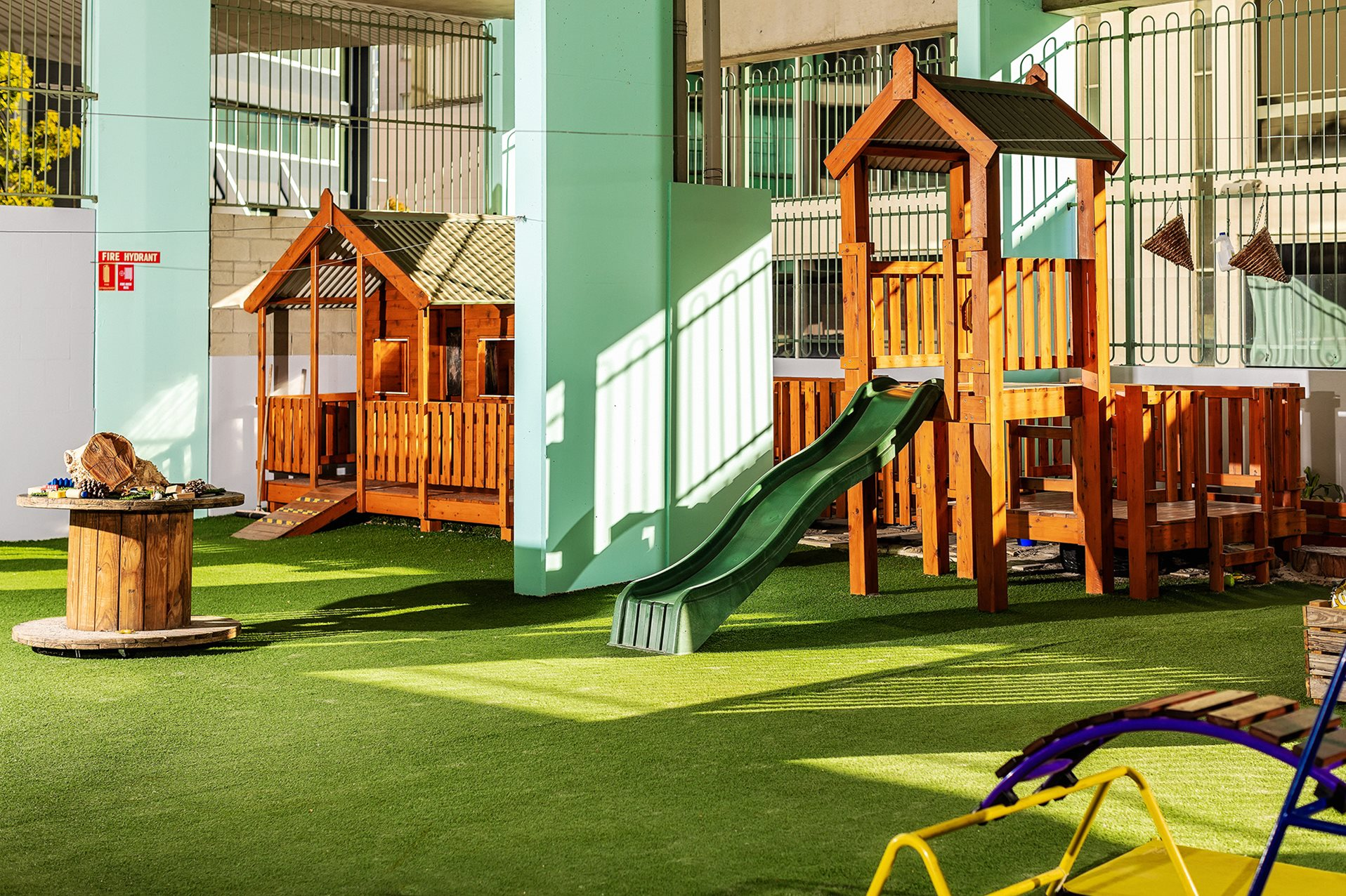 Outdoor fort with green slide at Papilio Spring Hill